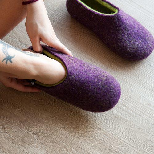 Lady is wearing purple Wooppers women's clogs