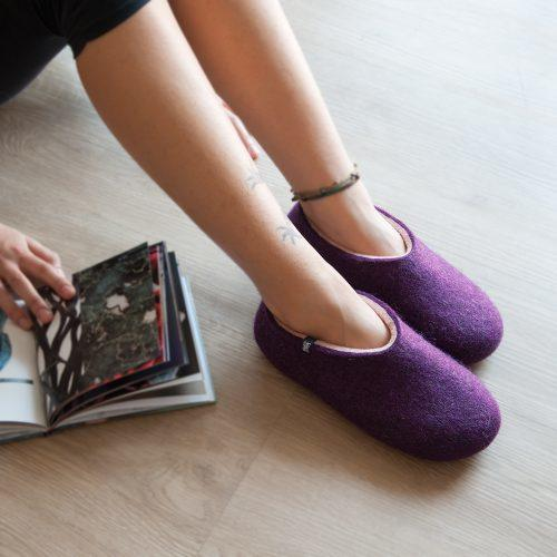 Lady wearing aubergine slippers from the new Dual Purple Wooppers collection
