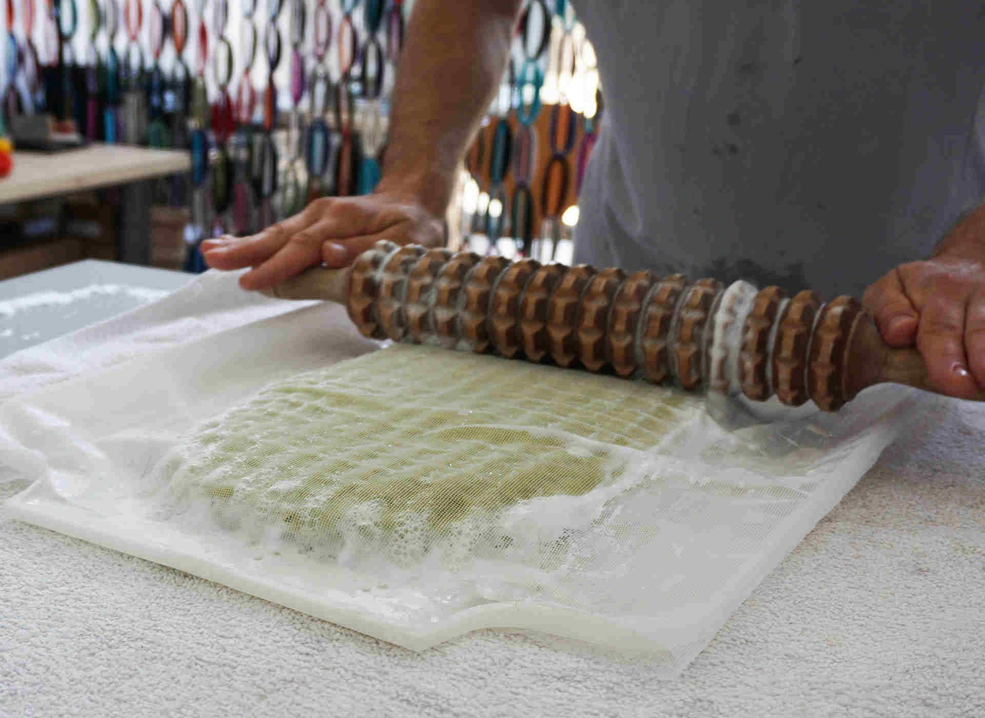 pressing and rubbing the wool